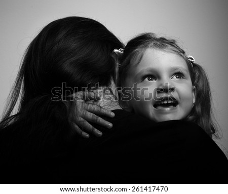 Mother and smiling enjoying daughter hugging. Closeup. Black and white portrait - stock photo