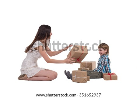 Mother and son are playing near the Christmas gifts on a white background