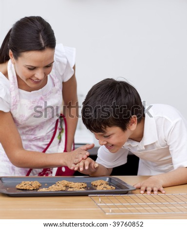 Mother and son baking biscuits together in the kitchen