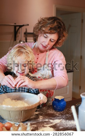Mother and son baking together in kitchen