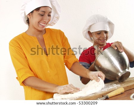 Mother and son cooking pizza. - stock photo