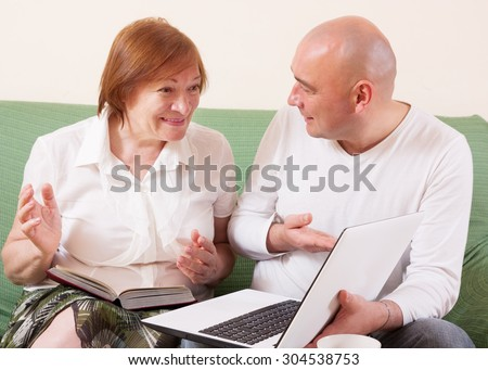 Mother and son discussing a new laptop