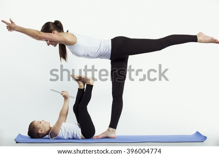 mother and son doing yoga (sports exercises), have fun and spend a good time together . isolated on white. the concept of a healthy lifestyle - stock photo