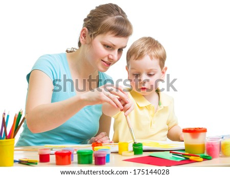 mother and son drawing or painting together isolated on white - stock photo