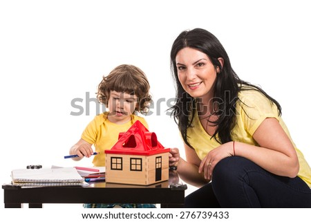Mother and son drawing together isolated on white background