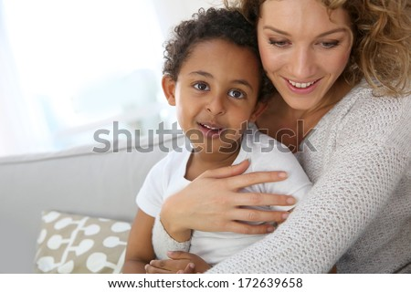 Mother and son embracing each other - stock photo