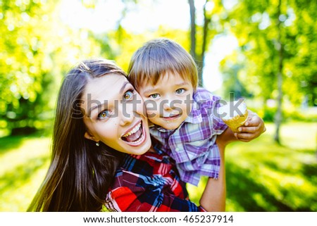 Mother and son happy in the park.Mother and Son Having Fun
