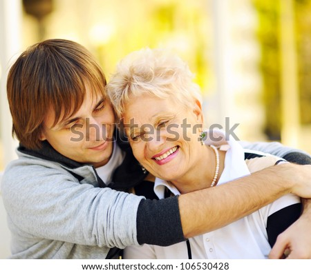 Mother and son having a hug - stock photo