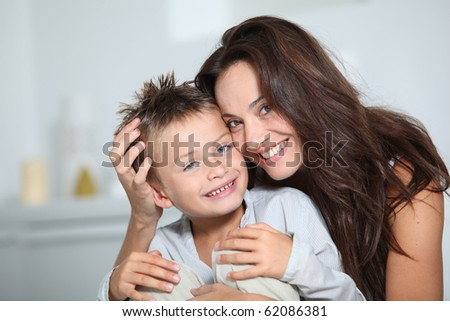 Mother and son having fun at home - stock photo