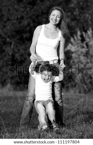 Mother and Son Having Fun.black and white - stock photo