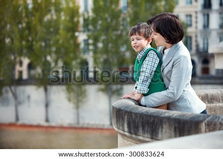 Mother and son having fun during summer vacation, Paris, France - stock photo