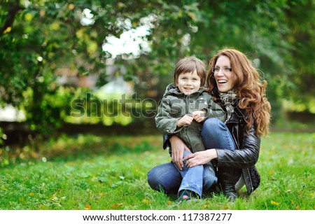 Mother and son having fun in a park