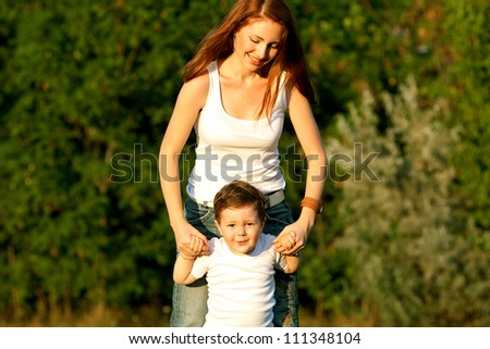 Mother and Son Having Fun outdoors - stock photo