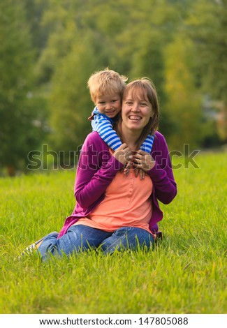mother and son having fun outdoors