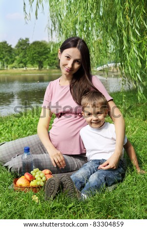 Mother and son having picnic on summer sunny day
