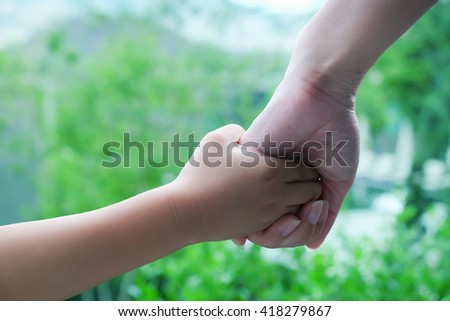 Mother and son holding hand with copy space