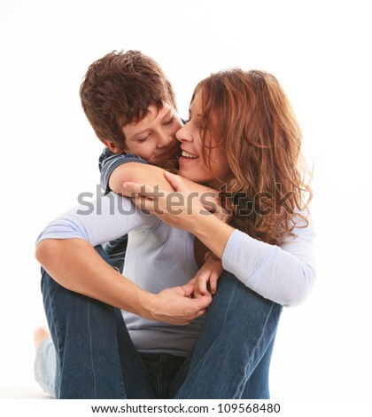 Mother and son in a loving pose isolated on a white background. - stock photo