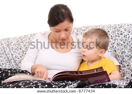 mother and son in bed with book - relax