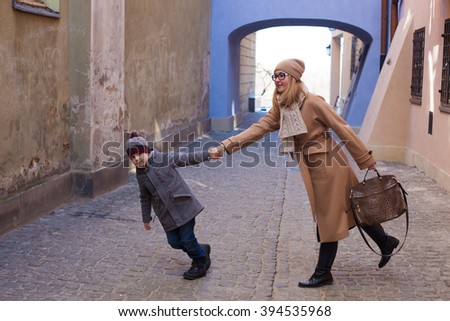 Mother and son in old town Warsaw. Poland - stock photo