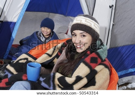 Mother and son (7-9) in tent, (portrait) - stock photo