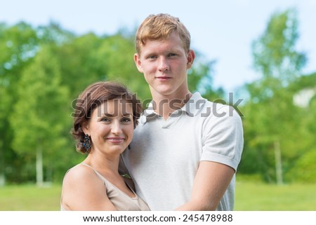 Mother and son in the park summer day - stock photo