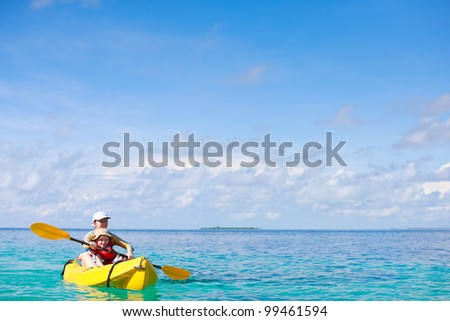Mother and son kayaking at tropical ocean - stock photo
