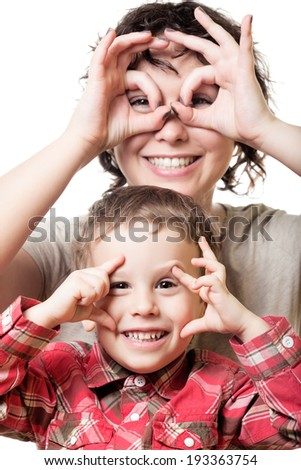 Mother and son keep their eyes wide open on isolated white - stock photo