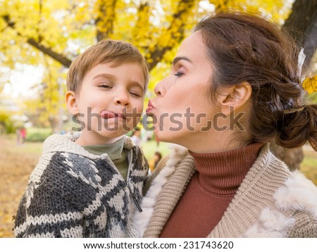 Mother and son making faces