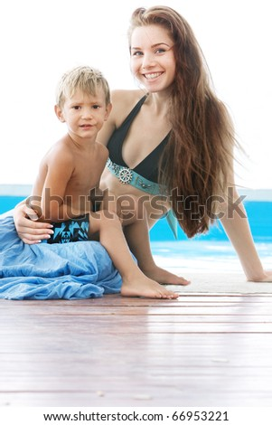 mother and son near waterpool - stock photo
