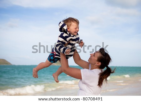 Mother and son on a tropical beach - stock photo