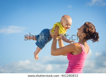Mother and son on the beach