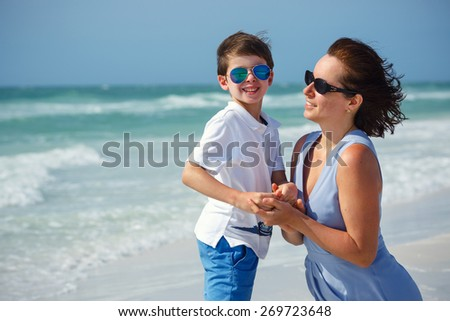 Mother and son on tropical beach on Florida summer holiday vacation - stock photo
