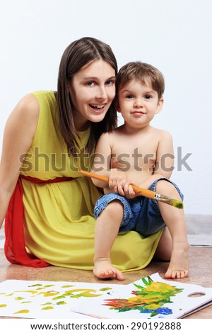 Mother and son or Creative child, Creative studio, Creative background, Painting brush - stock photo
