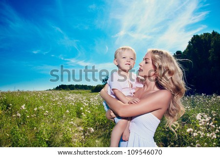 Mother and son outdoor - stock photo