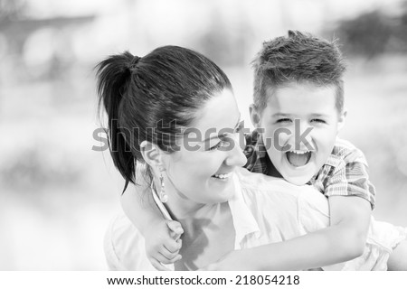 Mother and son outdoors - stock photo