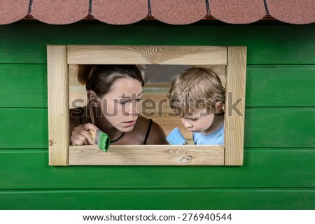 Mother and son painting - stock photo