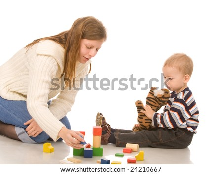 mother and son play with bricks