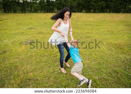 mother and son playing in the field