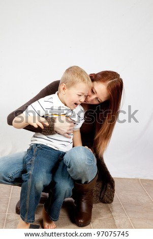Mother and son playing, mother holding him uside down