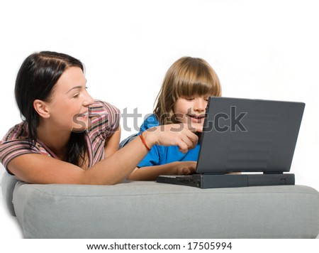 Mother and son playing with laptop