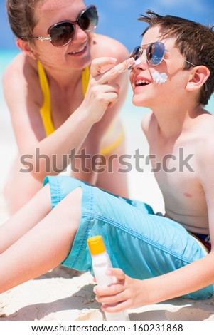 Mother and son portrait on beach vacation - stock photo