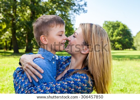 mother and son press nose together