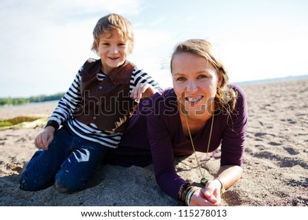 Mother and son relaxing and spending time together on the beach.