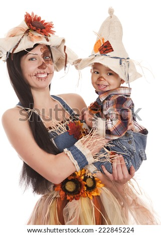 Mother and son scarecrows. Isolated on white. - stock photo