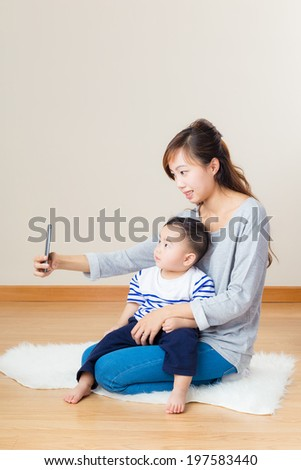 Mother and son selfie - stock photo