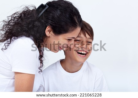 Mother and son sharing a funny moment laughing with joy - stock photo
