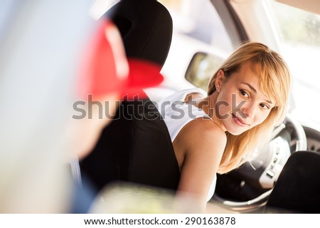 Mother and son sitting in the car and discuss the upcoming visit on holiday - stock photo