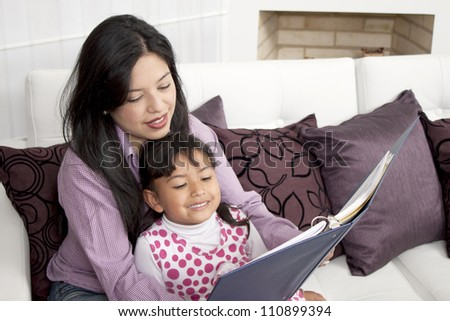 Mother and Son studying in the home - stock photo