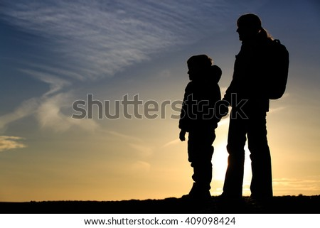 mother and son travel at sunset