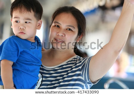 Mother and son travel with train